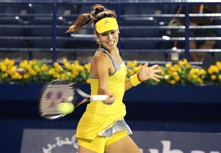 Ana Ivanovic of Serbia hits a return to Anastasia Pavlyuchenkova of Russia during their women's singles match at the WTA Dubai Tennis Championships, February 18, 2013. REUTERS/Ahmed Jadallah