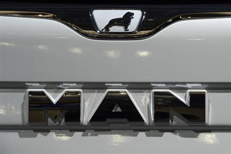 Logo of German truckmaker MAN, is pictured at the IAA truck show in Hanover, September 18, 2012. Picture taken September 18. REUTERS/Fabian Bimmer (GERMANY - Tags: BUSINESS TRANSPORT)