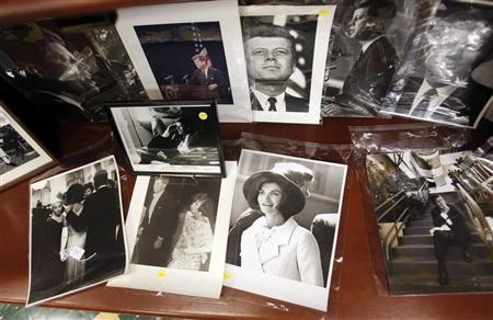 Photos of former U.S. President John F. Kennedy and his wife Jacqueline Kennedy Onassis are displayed among other items as part of the McInnis Auctioneers Presidential Auction in Amesbury, Massachusetts February 10, 2013. REUTERS/Jessica Rinaldi
