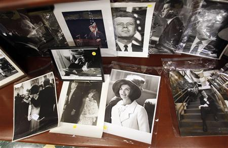 Photos of former U.S. President John F. Kennedy and his wife Jacqueline Kennedy Onassis are displayed among other items as part of the McInnis Auctioneers Presidential Auction in Amesbury, Massachusetts in this file photo from February 10, 2013. REUTERS/Jessica Rinaldi/Files