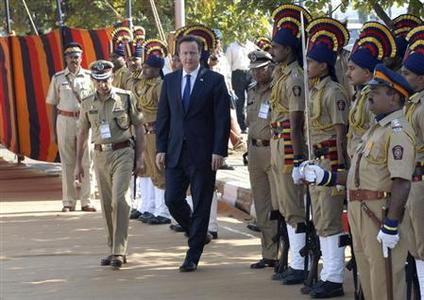 Britain's Prime Minister David Cameron arrives to pay tributes at a memorial dedicated to policemen who lost their lives in November 2008 attacks, in Mumbai February 18, 2013. REUTERS/Stringer