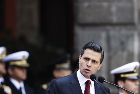 Mexican President Enrique Pena Nieto gives a speech after receiving a sword and a sabre by Navy Admiral Vidal Francisco Soberon and Defense Minister General Salvador Cienfuegos (both not pictured) as the supreme commander of the armed forces during an event at the Palacio Nacional in Mexico City February 15, 2013. REUTERS/Henry Romero