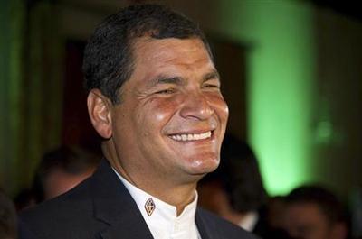 Ecuador's re-elected Correa vows media and land...