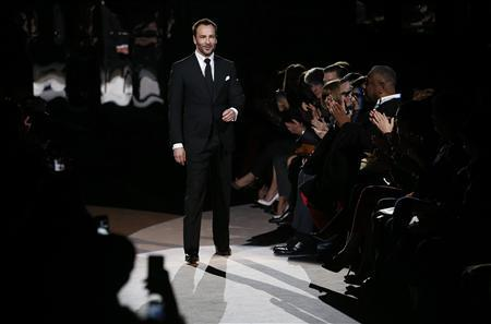 Designer Tom Ford walks on the catwalk following the presentation of the Tom Ford Autumn/Winter 2013 collection during London Fashion Week, February 18, 2013. REUTERS/Suzanne Plunkett