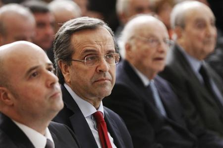 Greece's Prime Minister Antonis Samaras (2nd L) attends the ''Initiative Against the Crisis'' news conference by Stavros Niarchos foundation at Zappeion hall in Athens February 18, 2013. REUTERS/John Kolesidis