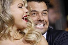 "Cast member Josh Duhamel and his wife, Fergie, pose during the premiere of ""New Year's Eve"" at the Grauman's Chinese theatre in Hollywood, California, December 5, 2011. REUTERS/Mario Anzuoni"