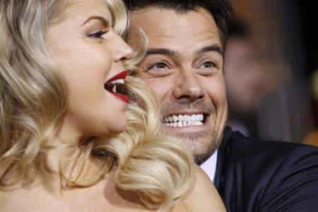 Cast member Josh Duhamel and his wife, Fergie, pose during the premiere of ''New Year's Eve'' at the Grauman's Chinese theatre in Hollywood, California, December 5, 2011. REUTERS/Mario Anzuoni