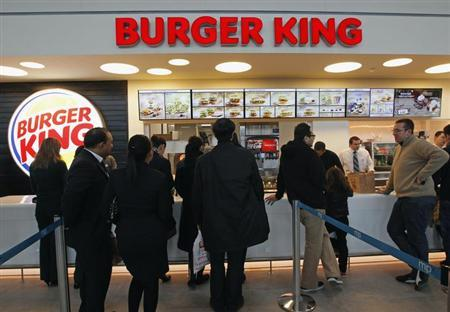 Customers queue up on the opening day of the Burger King restaurant at the Marignane airport hall December 22, 2012. REUTERS/Jean-Paul Pelissier/Files