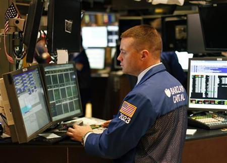 A trader works on the floor of the New York Stock Exchange, February 15, 2011. REUTERS/Joshua Lott/Files
