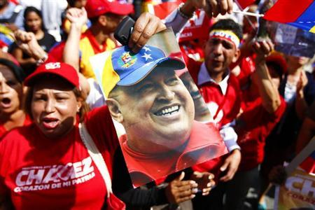 Supporters of Venezuela's President Hugo Chavez gather at Plaza Bolivar in Caracas February 18, 2013. REUTERS/Carlos Garcia