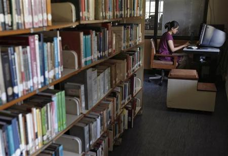 A Master of Business Administration (MBA) student works on a computer in a library at Management Development Institute (MDI) in Gurgaon, on the outskirts of New Delhi May 2, 2012. REUTERS/Adnan Abidi/Files