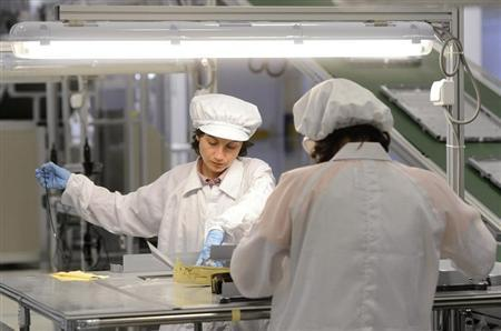 Employees work on LCD panels in the new AU Optronics plant in Trencin June 28, 2011. REUTERS/Radovan Stoklasa