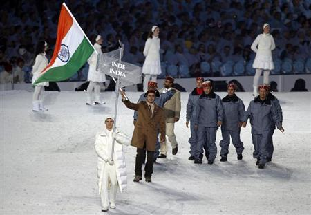 Flag bearer Shiva Keshavan of India leads his country's contingent during the opening ceremony of the Vancouver 2010 Winter Olympics February 12, 2010. REUTERS/Mike Blake