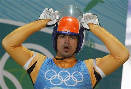 Shiva K.P. Keshavan of |ndia prepares to start a training run for the men's singles luge in preparation for the Vancouver 2010 Winter Olympics in Whistler, British Columbia, February 13, 2010. REUTERS/Tony Gentile/Files