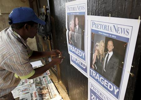 A newspaper vendor sets up his stall outside court ahead of South African ''Blade Runner'' Oscar Pistorius' court appearance in Pretoria February 15, 2013. REUTERS/Siphiwe Sibeko