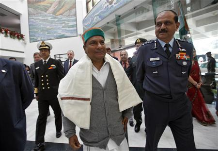 India's Defence Minister A.K. Antony (C) arrives to address a news conference at BrahMos Aerospace office in New Delhi February 19, 2013. Antony said on Tuesday it was ''too early'' to consider the possibility of foul play in a planned $10 billion deal with France's Dassault Aviation for Rafale war planes. REUTERS/Mansi Thapliyal