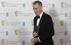 "Daniel Day-Lewis celebrates after winning the Best Actor award for ""Lincoln"" at the British Academy of Film and Arts (BAFTA) awards ceremony at the Royal Opera House in London February 10, 2013. REUTERS/Suzanne Plunkett"