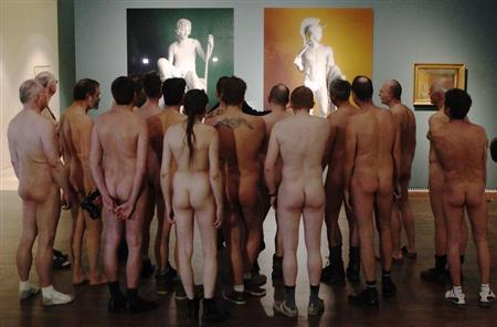 Nude visitors looks at the laserchrome prints ''Shepherd Boy'' (L) and ''Jason'' by Michael Elmgreen and Ingar Dragset at the art exhibition ''Nude Men'' at Leopold museum in Vienna February 18, 2013. REUTERS/Heinz-Peter Bader