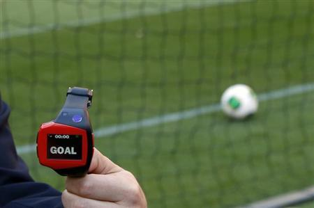 A FIFA official holds a wrist watch used as part of the Hawk-Eye goal-line technology, which will be used in Sunday's Club World Cup quarter-finals, at the Toyota Stadium in Toyota, central Japan December 8, 2012. REUTERS/Toru Hanai/Files