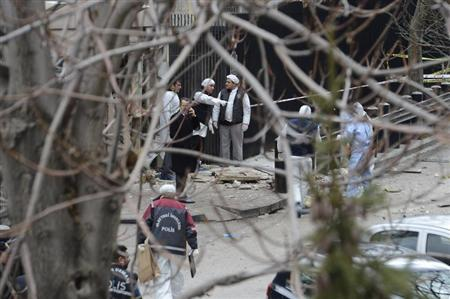 Turkish police forensic experts inspect the site after an explosion at the entrance of the U.S. embassy in Ankara February 1, 2013. REUTERS/Stringer