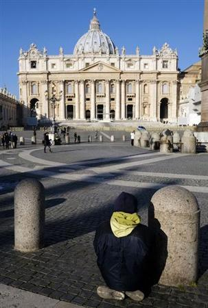 A faithful kneels down in front of St. Peter's Basilica at the Vatican February 19, 2013. Pope Benedict's shock resignation has robbed Italians of the one element of certainty in a time of deep doubt, with the country beset by graft scandals and heading for an election that will not bring the radical change so many crave. REUTERS/Max Rossi (VATICAN - Tags: RELIGION) - RTR3DZB6