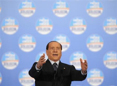 Former Italian Prime Minister Silvio Berlusconi speaks during a political rally in Turin February 17, 2013. REUTERS/Giorgio Perottino