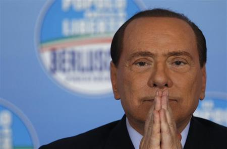 Italy's former prime minister Silvio Berlusconi attends a news conference at the People of Freedom Party (PDL) headquarters in Rome February 1, 2013. REUTERS/Alessandro Bianchi