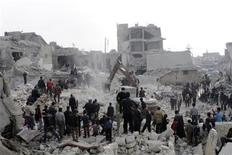 An excavator is used to search for survivors after a Syrian army rocket attack on the rebel-held Jabal Badro district in the city of Aleppo February 19, 2013. The attack killed at least 20 people and another 25 were missing, opposition activists said on Tuesday. The missile was identified from its remains as a Scud-type rocket that government forces have increasingly used in areas under opposition control in the province of Aleppo and in the province of Deir a-Zor to the east, they said. REUTERS/Hamid Khatib