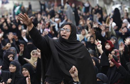 A Shi'ite Muslim woman shouts slogans during a protest against Saturday's bomb attack in Quetta's Shi'ite area in Lahore February 19,2013. REUTERS/Mohsin Raza