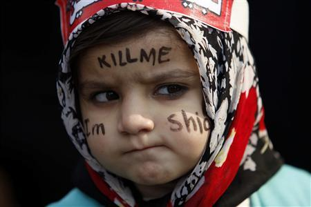 A Shi'ite Muslim girl attends a protest against Saturday's bomb attack in Quetta's Shi'ite Muslim area, in Lahore February 19, 2013. Pakistani Shi'ites furious over the sectarian bombing that killed 89 people protested on Monday, demanding that security forces protect them from hardline Sunni groups. REUTERS/Mohsin Raza