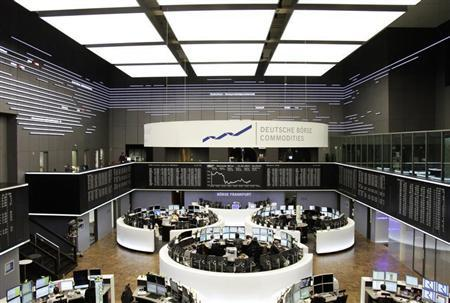 Traders are pictured at their desks in front of the DAX board at the Frankfurt stock exchange February 14, 2013. REUTERS/Pawel Kopczynski (GERMANY - Tags: BUSINESS) - RTR3DS90