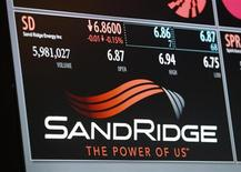 An electronic display identifies the post that trades SandRidge Energy stock on the floor of the New York Stock Exchange, January 11, 2013. REUTERS/Brendan McDermid