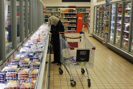 People shop at a supermarket in London February 16, 2013. REUTERS/Luke MacGregor