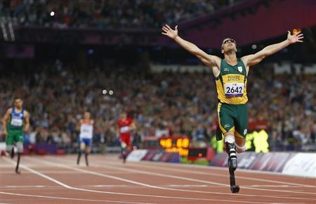 Oscar Pistorius of South Africa celebrates winning the Men's 400m T44 Final during the London 2012 Paralympic Games at the Olympic Stadium in London September 8, 2012. REUTERS/Andrew Winning