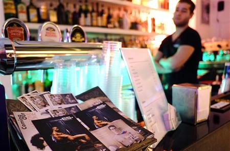 A bartender looks on in the ''Coming Out'' bar, Rome's best known gay bar, next to the Colosseum in downtown Rome February 18, 2013. Picture taken February 18, 2013. REUTERS/Max Rossi