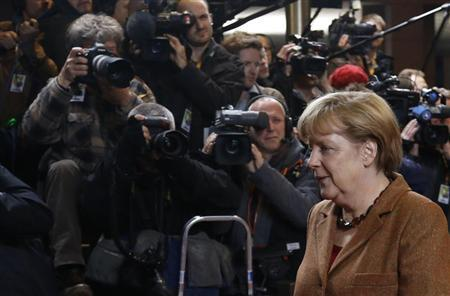 Germany's Chancellor Angela Merkel arrives at the EU council headquarters for an European Union leaders summit discussing the European Union's long-term budget in Brussels November 22, 2012. REUTERS/Francois Lenoir