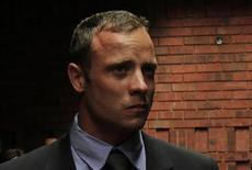 """Blade Runner"" Oscar Pistorius awaits the start of court proceedings in the Pretoria Magistrates court February 19, 2013. Pistorius, a double amputee who became one of the biggest names in world athletics, was applying for bail after being charged in court with shooting dead his girlfriend, 30-year-old model Reeva Steenkamp, in his Pretoria house. REUTERS/Siphiwe Sibeko"