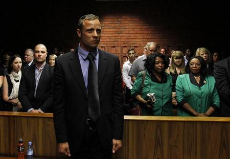 ''Blade Runner'' Oscar Pistorius awaits the start of court proceedings in the Pretoria Magistrates court February 19, 2013. REUTERS/Siphiwe Sibeko