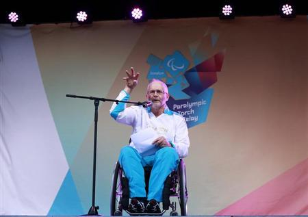 Paralympian and International Paralympic Committee (IPC) President Philip Craven speaks during the torch relay ceremony at Stoke Mandeville Stadium in Buckinghamshire August 28, 2012. REUTERS/Olivia Harris/Files