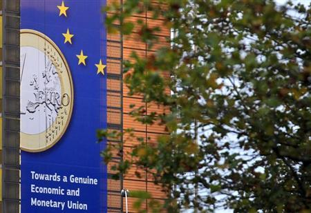 A banner featuring a Euro coin is seen at the European Commission headquarters building in Brussels October 18, 2012. REUTERS/Yves Herman/Files