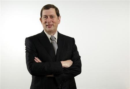 John Martin, CEO of Gilead, poses before speaking to reporters during the Reuters 2006 Biotechnology Summit in Los Angeles February 23, 2006.
