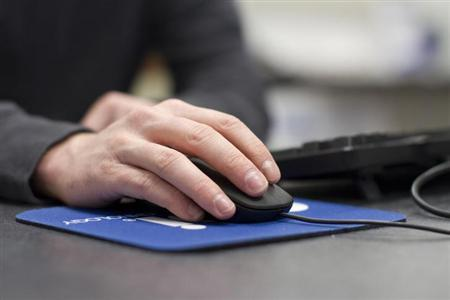 A U.S. Marine Sergeant works on a computer in Virginia Beach, Virginia, February 7, 2012. REUTERS/Samantha Sais/Files
