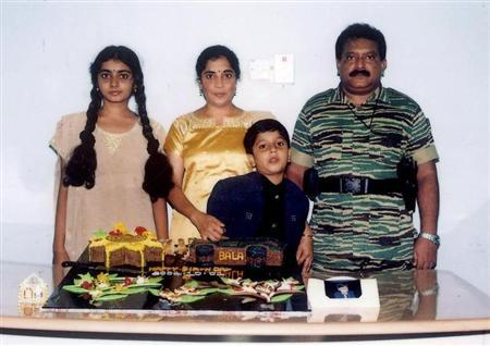 An undated picture supplied by the Sri Lankan Ministry of Defence shows the Liberation Tigers of Tamil Eelam (LTTE) leader Vellupillai Prabhakaran (R) standing with his wife Mathivathani (2nd L), son Balachandran and daughter Duwaraka (L) from a collection of photographs that government soldiers said they discovered recently in a ''hideout'' in northern Sri Lanka. REUTERS/Sri Lankan Ministry of Defence/Handout/Files