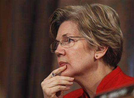 Senator Elizabeth Warren (D-MA) listens to answers during a testimony while sitting on the Senate Banking, Housing and Urban Affairs Committee in Washington February 14, 2013. REUTERS/Gary Cameron