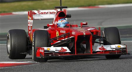 Ferrari's Formula One driver Fernando Alonso of Spain takes a curve during a training session at the Circuit de Catalunya racetrack in Montmelo, near Barcelona, February 19, 2013. REUTERS/Albert Gea