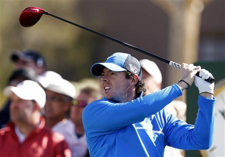 Rory McIlroy of Northern Ireland watches his tee shot on the 10th hole during a practice round for the WGC-Accenture Match Play Championship golf tournament in Marana, Arizona February 19, 2013. REUTERS/Matt Sullivan