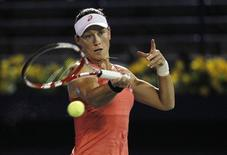 Samantha Stosur of Australia hits a return to Ekaterina Makarova of Russia during their women's singles match at the WTA Dubai Tennis Championships, February 19, 2013. REUTERS/Jumana El Heloueh