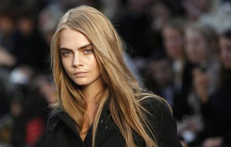 Model Cara Delevingne presents a creation from the Burberry Prorsum Autumn/Winter 2013 collection during London Fashion Week, February 18, 2013. REUTERS/Suzanne Plunkett