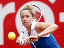 La Française Pauline Parmentier a été éliminée mardi au premier tour du tournoi WTA de Bogota, en Colombie, battue 7-5 6-4 par la Croate Tereza Mrdeza. /Photo prise le 19 février 2013/REUTERS/John Vizcaino