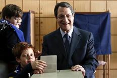 Cyprus presidential candidate Nicos Anastasiades of the right wing Democratic Rally party and his grandsons cast a ballot at a polling station in Limassol February 17, 2013. REUTERS/Yorgos Karahalis